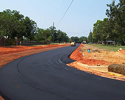 a newly paved curving road