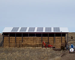 outside of a barn with solar panels on the roof