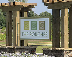 photo of a sign that says the porches