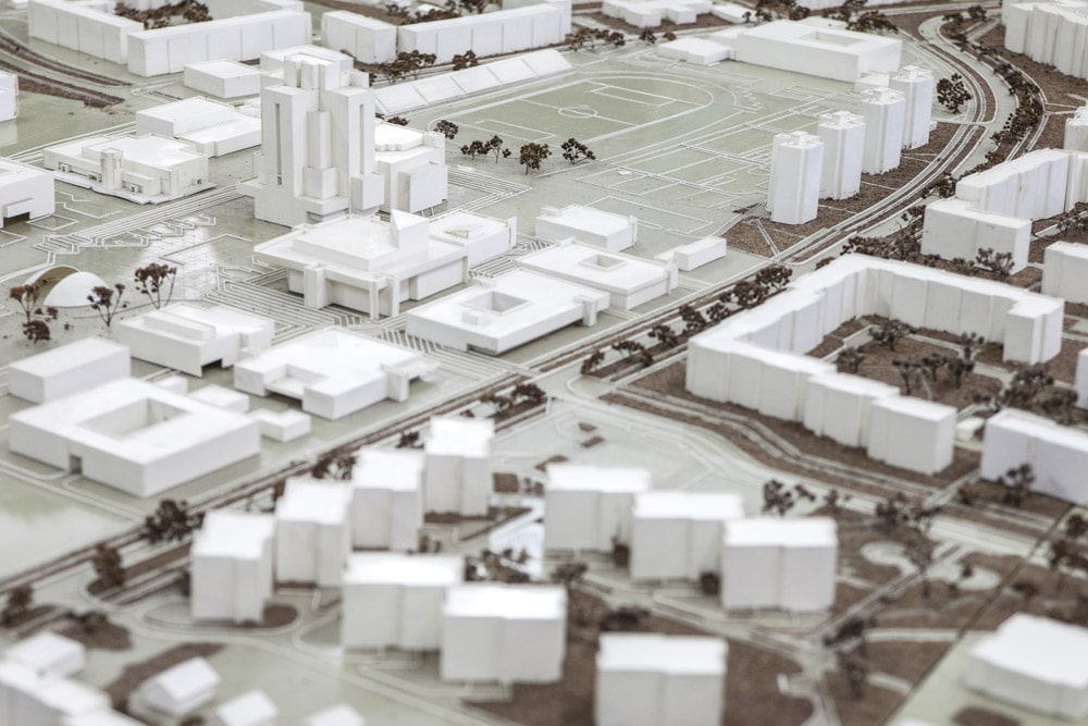 overhead shot of a city model with all white buildings