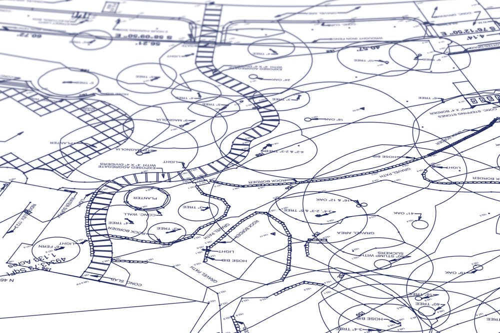 civil engineering plans on white background with blue ink